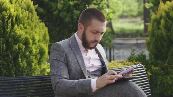 Businessman scroling tab