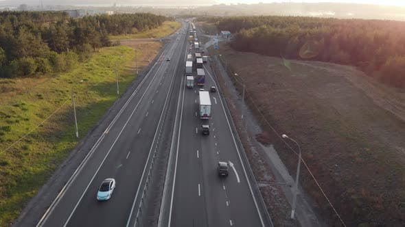 Aerial View. Intercity Highway Section. Congestion on the Road. Cars and Wagons Are Standing in a