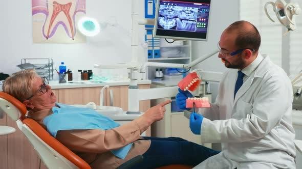 Explaining Procedure Using Model of Dental Teeth
