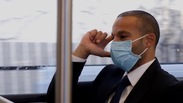 Thumbnail for Businessman wearing face mask rides train to work