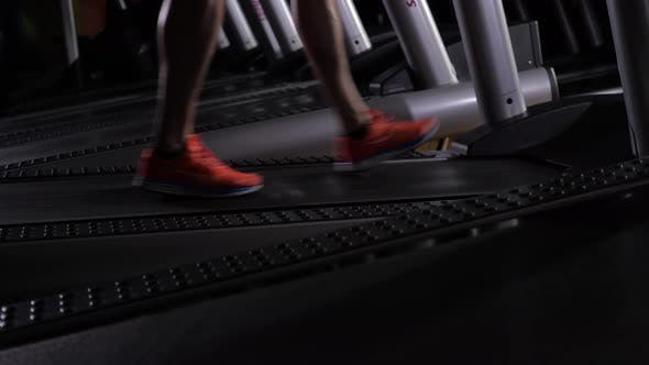 Thumbnail for Men's Feet in Red Sneakers on the Treadmill