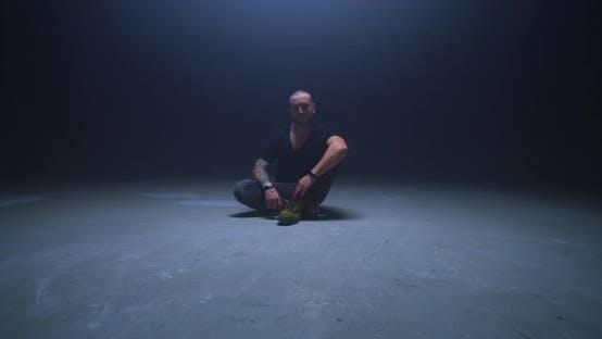 Thumbnail for Man Sitting on Floor in Dark Room