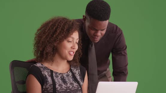 Thumbnail for Two black millennials working on green screen