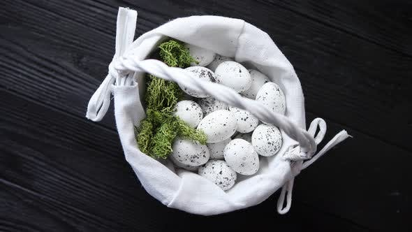 Thumbnail for Quail Eggs in a Nest on a Black Rustic Wooden Background