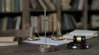 Judge Pass Through Gavel and Gold Brass Balance Scale on Judge Table