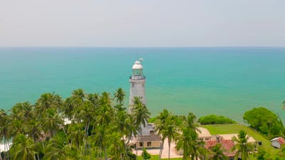 White Lighthouse on the Tropical Island the Indian Ocean