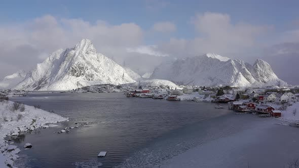 Thumbnail for Clouds Run Quickly over the Winter Norwegian Town