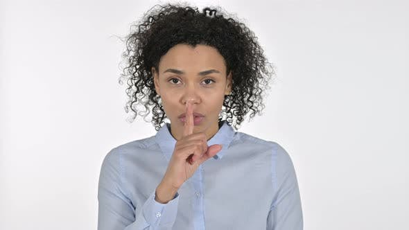 Thumbnail for Portrait of Young African Woman Putting Finger on Lips