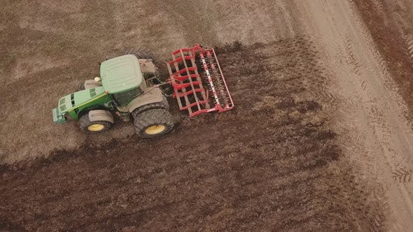 Thumbnail for Tractor Plows a Field, Aerial View