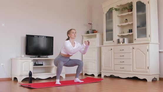 Thumbnail for Attractive slim girl practicing exercise for butt muscles at home due to quarantine