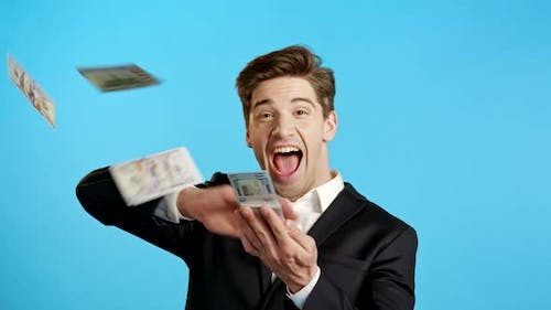 Business Man with Happy Face Scatters Money. People Overspend US Currency. Guy Is Flush with Dollars