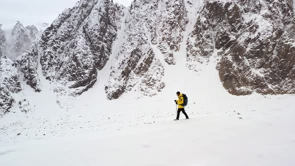 Thumbnail for Young Man Walking Up Mountain Slope Backpacking Winter Hike Extreme Conditions Swiss Alps Aerial