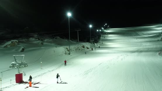 Thumbnail for Skiers At Night Aerial View