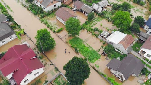 Aerial View Floods and Flooded Houses. Mass Natural Disasters and Destruction. A Big City Is Flooded