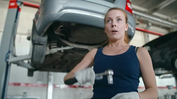 Thumbnail for Woman Repairing Car Bottom