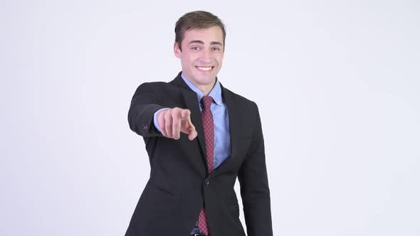 Cover Image for Young Happy Handsome Businessman Pointing To Camera