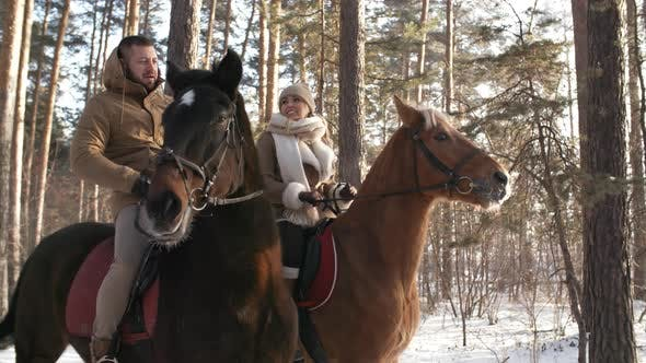 Thumbnail for Man and Woman Enjoying Horse Riding on Winter Day