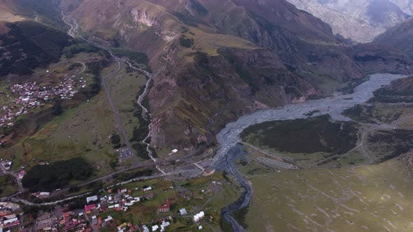 River Valley And Village In The Mountains