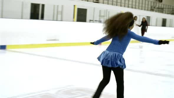 Thumbnail for Girl in Blue Dress Practicing Ice Skating