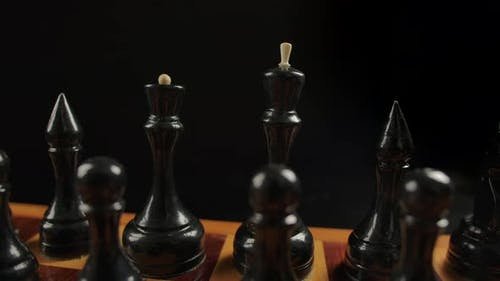 Black Chess Pieces on a Checkerboard in the Starting Position