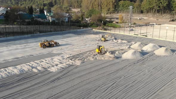 Excavators Level the Site with Sand, Moving Sand From the Mounds