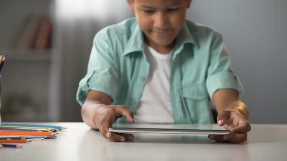 Thumbnail for Little Boy Actively Playing on Tablet After School, Online Gaming Addiction