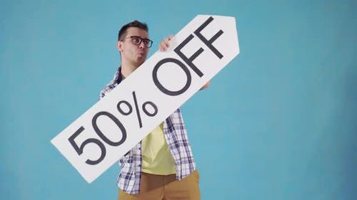 Funny Man with in Glasses with 50 Off Sign
