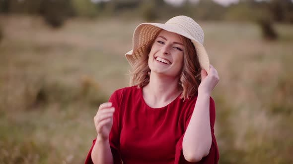 Thumbnail for Smiling Woman Laughing and Looking Into Camera
