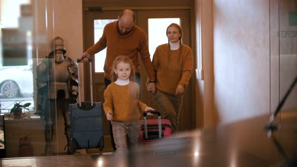 Thumbnail for A Happy Family in Similar Clothes Entering the Luxury Hotel