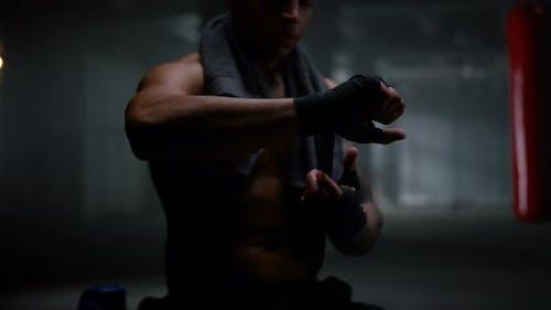 Man Preparing for Kickboxing Fight