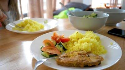 Turmeric Pilau Rice Dish Served Salad Sliced Tomato and Cucumber Slices