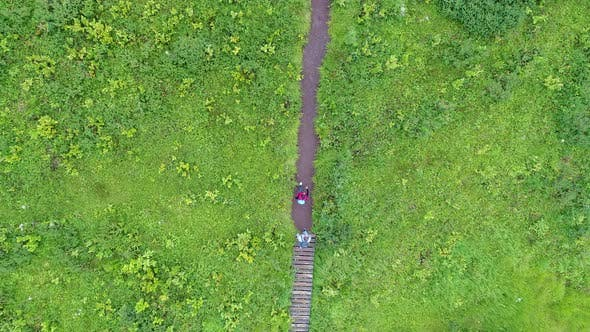 Thumbnail for Two Tourists Going On A Track to Sayansk Mountains