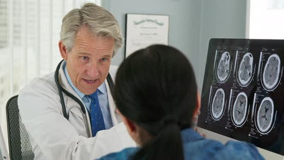 Thumbnail for Over the shoulder shot of doctor explaining test results to female patient