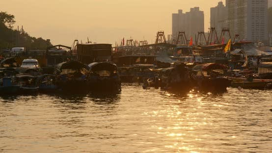 Thumbnail for Hong Kong harbor port in aberdeen at sunset time