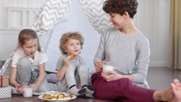 Thumbnail for Happy Family Eating Cookies with Milk beside Teepee in Kids Room