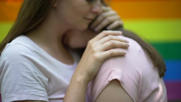 Lesbian Couple Embracing Tenderly, Publicly Expressing Feelings, Same-Sex Love