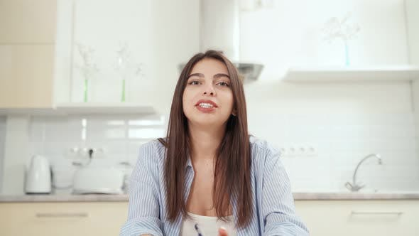 Brunette Woman Telling Information to Camera Online