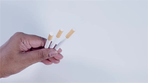 Thumbnail for Hand Holding 3 Cigarettes