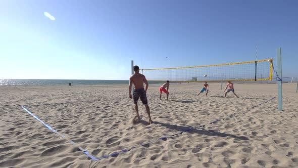 Thumbnail for Men playing beach volleyball.