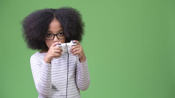 Thumbnail for Young Cute African Girl with Afro Hair Playing Games