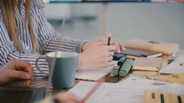 Thumbnail for Close-up Busy Corporate Company Workers Sit Behind Office Table with Devices and Coffee at Staff