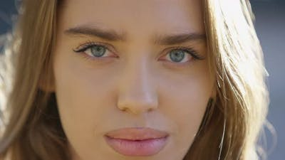 Close up of a young woman winking