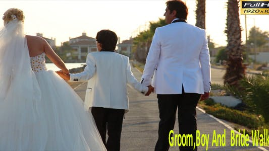 Thumbnail for Groom,Boy And  Bride Walking
