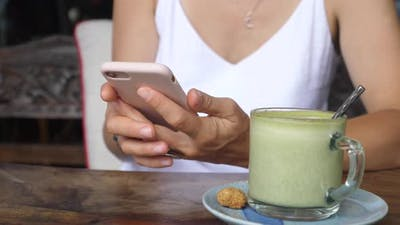 Close Up of Female Texting in a Coffee Place