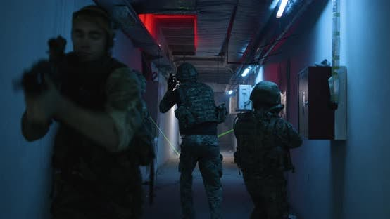Thumbnail for SWAT Team with Commander Walking in Dark Corridor