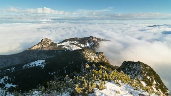 Thumbnail for Sunny Winter Morning Above Clouds in Foggy Mountains
