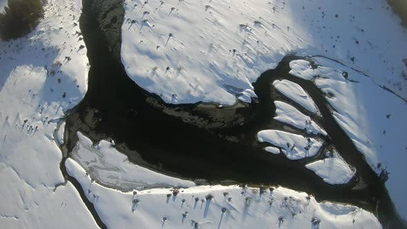 Thumbnail for Frozen Lake Snow Islands Birds Eye View Floating Aerial