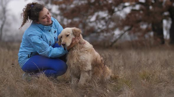 Thumbnail for Cheerful Woman Caressing Her Labrador Retriever