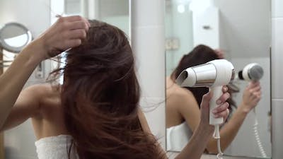 Hair Care. Woman Drying Long Hair With Hairdryer At Bathroom
