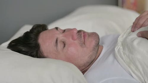 Peaceful Middle Aged Man Sleeping in Bed